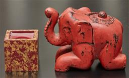 Sale 9108H - Lot 9 - A red lacquered timber elephant with lidded compartment Length 17cm together with a candle.