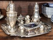 Sale 8942H - Lot 69 - A small group of silver plated cruet wares on a shaped squared tray