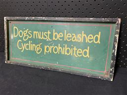 Sale 9188 - Lot 1094 - Cast iron DOGS MUST BE LEASHED painted sign (h:21 x w:47cm)
