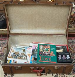 Sale 9103M - Lot 554 - A large travelling trunk consisting of teddy bears and toys related books.