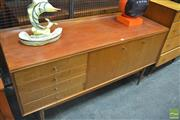 Sale 8275 - Lot 1029 - Compact teak sideboard by Austin Suite