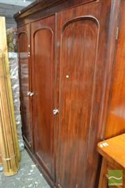 Sale 8460 - Lot 1079 - Victorian Mahogany wardrobe with three panel doors and fitted interior