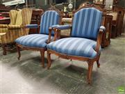 Sale 8559 - Lot 1041 - Pair of Louis XVI Style Transitional Walnut Armchairs, upholstered in blue striped fabric and on cabriole legs