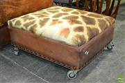 Sale 8235 - Lot 1044 - Pair of Giraffe Hide and Leather Ottomans