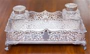 Sale 8346A - Lot 23 - A late Victorian pierced sterling silver desk set, Carrington & Co, London, with pierced and scrolled decoration raised on ball feet...