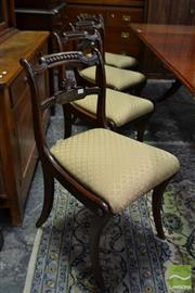 Sale 8500 - Lot 1013 - Set of Four Regency Simulated Rosewood Dining Chairs with Brass inlay, Drop in Seats and Sabre Legs