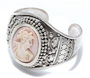 Sale 9046 - Lot 369 - A SILVER CAMEO CUFF BANGLE; centring a 34 x 26mm carved pink shell cameo featuring a classical portrait to surround and shoulders ap...