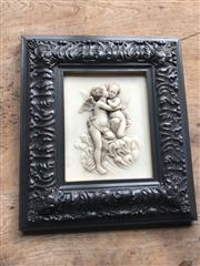 Sale 8782A - Lot 123 - A carved and framed marble panel depicting cupids, 43 x 37cm