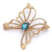 Sale 9083 - Lot 437 - A 9CT GOLD GEMSET BUTTERFLY BROOCH; set with an approx. 0.90ct oval cut blue topaz and a round cut white stone (chipped), size 32 x...