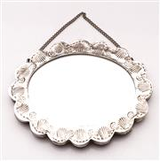 Sale 9078 - Lot 70 - A Burmese sterling silver small mirror, of oval form D16cm