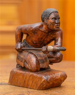 Sale 9160H - Lot 52 - A carved Maori kneeling warrior figure, carved by goodsall Muriwai c. 1950, Height 21cm x Length 15cm