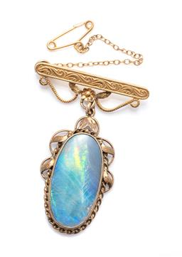 Sale 9253J - Lot 497 - A VINTAGE GOLD PLATED OPAL PENDANT BROOCH; pendant featuring an oval triplet opal to twist and leaf surround, to later engraved bar...