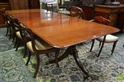 Sale 8500 - Lot 1012 - Georgian Style Mahogany Extension Dining Table, with three leaves, on turned pedestals with outswept feet
