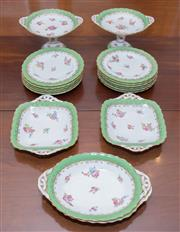 Sale 8346A - Lot 14 - A Coalport bone china dessert service comprising; 2 comports, 11 side plates, 2 oval serving dishes, 2 square serving dishes, in app...