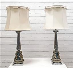 Sale 9126 - Lot 1108 - Pair of Brass Column Form Table Lamps, supported by cherubs & on marble plinths (h69cm, each) (minor damage to 1 x silk shade)