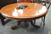 Sale 8267 - Lot 1078 - Good Victorian Figured Walnut Supper Table, the round tilt-top on a turned & carved pedestal