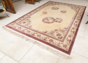 Sale 8677B - Lot 526 - A Chinese carpet with a grape border and typical design on cream ground, W x 245cm, L x 342cm