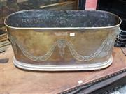 Sale 8714 - Lot 1021 - Large Brass Oval Lumber Bin or Jardiniere, with chased festoon & lion mask handles