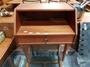 Sale 8782 - Lot 1092 - Teak Side Table with Single Drawer and Open Section