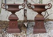 Sale 8972H - Lot 67 - A pair of cast iron urns and plinths, Height 81cm x Width 70cm