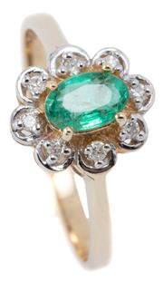 Sale 9046 - Lot 550 - A 9CT GOLD EMERALD AND DIAMOND CLUSTER RING; centring on an oval cut emerald within a scalloped surround set with 8 round brilliant...