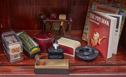 Sale 9103H - Lot 31 - A shelf lot of smoking related wares including pipes, ashtrays, dispensers and literature.