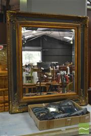 Sale 8326 - Lot 1202 - Black and Gilt Framed Mirror
