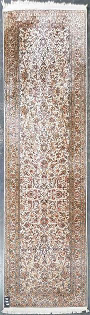 Sale 8993 - Lot 1040 - Kashmiri Silk Runner, with lotus arabesques on a cream ground, all in pastel tones (272 x 80cm)