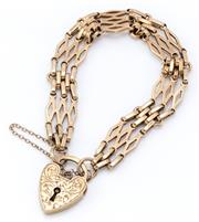 Sale 9020 - Lot 366 - A 9CT GOLD GATELINK PADLOCK BRACELET; 12.5mm wide links to engraved heart shape padlock clasp with safety chain, length 19cm, wt. 28...
