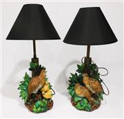 Sale 8362A - Lot 77 - A rare pair of antique majolica quail lamps with fitted brass stems, some small losses to leaf tips, height to top of bulb holders 4...