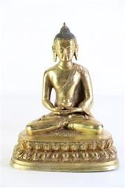 Sale 8997A - Lot 617 - Gilt Bronze figure of buddha Shakyamuni, with fine facial features holding an alms bowl seated in lotus position (H22.5cm)