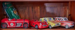 Sale 9103H - Lot 32 - A group of tins in the form of cars. length 29cm