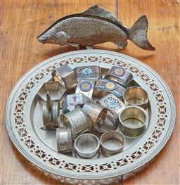 Sale 9103M - Lot 557 - A WS&S silverplated tray with pierced borders, Diameter 30cm, together with a quantity of napkin rings and a fish form napkin holder...