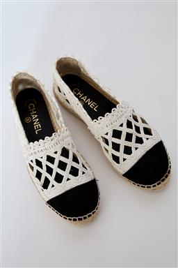 Sale 9095F - Lot 71 - A pair of Chanel black and white woven espadrilles, size 37.