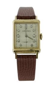 Sale 8406A - Lot 63 - A fine early Longines tank wristwatch in 14 K gold with diamond dial, 29 x 2 mm, hand winding, in working order