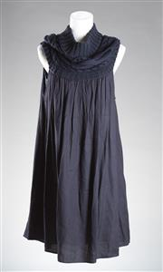 Sale 8493A - Lot 97 - A Cheap & Chic Moschino navy dress with knitted section to top, size 4