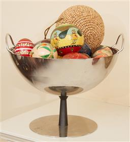 Sale 9097H - Lot 69 - A footed Alessi bowl containing various eggs, spheres and marbles, Diameter of bowl 25cm
