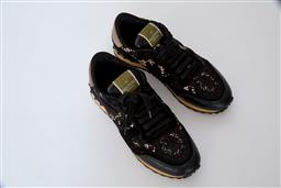 Sale 9095F - Lot 21 - A pair of Valentino Garavani black lace, suede and leather black and gold sneakers, size 37. Hardly worn.