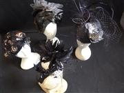 Sale 7982B - Lot 121 - Four monochrome fascinators, some with veils and feather details