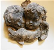Sale 8256A - Lot 56 - An early cast stone building remnant of two cherubs. Size: 27 x 30 cm