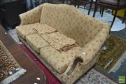 Sale 8291 - Lot 1049 - Georgian Style Camel Back Settee, with upholstered caramel fabric in floral pattern and carved fascia to the arms.
