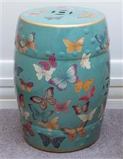 Sale 8800 - Lot 201 - A pair of Chinese polychrome drum stools, with butterflies on a turquoise ground, H 46cm