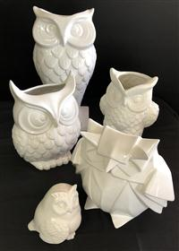 Sale 8725A - Lot 43 - A group of five white glazed pottery owls. Tallest 36cm
