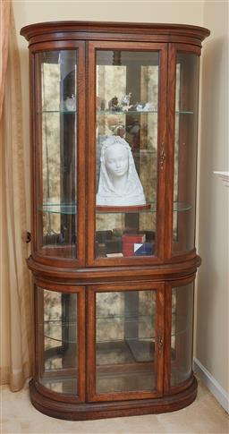 Sale 9097H - Lot 66 - A pair of elm bowfront display cabinets with convex glass panelled sides and fronts and mirror to back, Height 183cm x Width 95cm x...