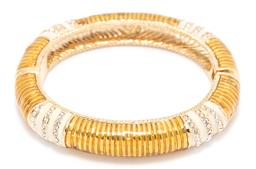Sale 9168J - Lot 341 - A ST JOHN GOLD TONE BANGLE; 11mm wide hinged bangle with magnetic clasp, with enamel and rhinestone decoration, internal diam 60mm,...
