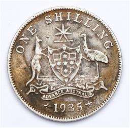 Sale 9156 - Lot 232 - An Australian 1935 silver shilling with six pearls