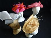 Sale 7982B - Lot 142 - Four straw fascinators of various colours