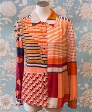 Sale 8474A - Lot 40 - A stylish Tory Burch 100% silk blouse, in excellent condition, size 8