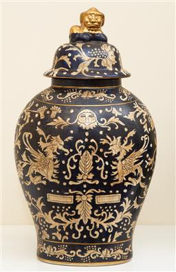 Sale 9190W - Lot 53 - A chinese ceramic lidded vase on black ground with gilt fo dog finial. Height 41cm