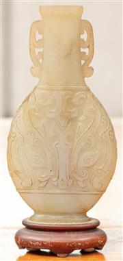 Sale 8976H - Lot 63 - A Chinese Carved nephrite specimen vase of compressed form and carved with taotie Height 11.5cm